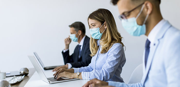 Group of business people have a meeting and working in the office and wear masks as protection from corona virus